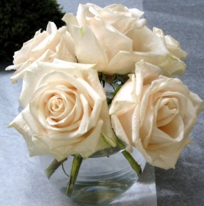A bubble bowl of Vandella Roses (a light cream color).  This can be a casual centerpiece  or decor for a cocktail table.