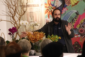 Tom is demonstrating different floral varieties and how we use them at Starbright Floral Design.