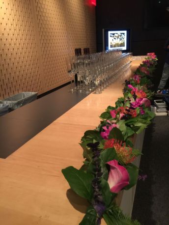 The length of the bar was lined with calla lilies mixed with greens.