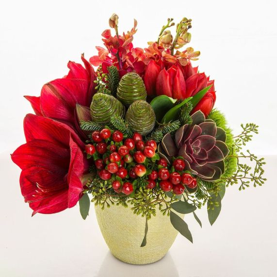 Eye-catching berries take center stage with soft succulents enhancing the differing textures.