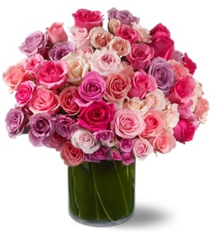 Starbright's fresh roses are paired with verdant Ti leaves for an incredible display.