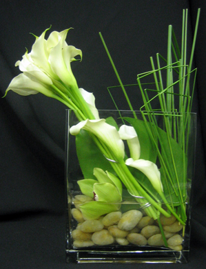 Calla lilies and blades of grass are combined to brilliant effect.