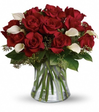 Starbright's Be Still My Heart bouquet is composed of lush roses and lilies that would make anyone swoon.