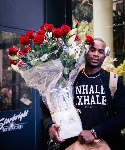 "InStyle said, ""Alex (24) who gets flowers for his lady once a week got a large bouquet of red roses for Valentine's Day. He says getting flowers for her is a fresh display of his love for her."" -- photo by egozdes@gmail.com"